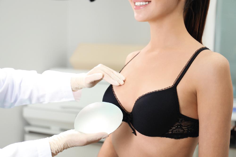 surgeon presenting breast implants